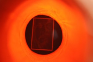 view of the print through a camera's viewfinder inside the traffic cones